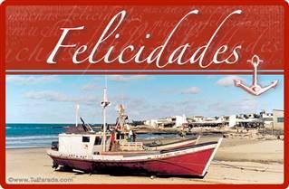 Felicidades con barco y playa