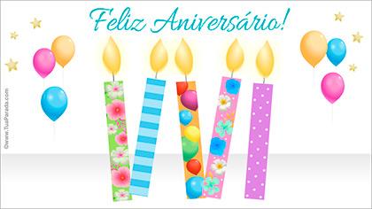 Cartão de aniversário com velas coloridas