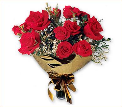 Doce rosas de 1° calidad en ramo redondo