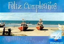 Feliz cumpleaños con barcos en la playa